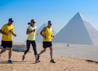From right: CEO of the Boston Marathon organizing body Tom Grilk joined Boston Marathon winners Lisa Rainsberger (1985) and Greg Meyer (1983) as the Bureau of Educational and Cultural Affairs' sports envoys to Egypt, Oct. 23–28, 2018. The three runners mentored Egyptian race organizers from Alex Runners and Cairo Runners and held clinics for local runners, women and youth, including a 5K run past the Giza Pyramids.