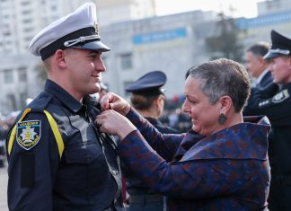 Bureau of International Narcotics and Law Enforcement Affairs (INL) Assistant Secretary Kirsten D. Madison presents a pin to a Kyiv Patrol Police Academy graduate during a visit to Ukraine last October. Through a partnership with Ukraine's Ministry of Internal Affairs, INL supported the overhaul and rollout of the more than 16,000-member Patrol Police nationwide, which replaced the corrupt and inefficient traffic police with a protect-and-serve force. Public approval for the new Patrol Police units reached an unprecedented 70 percent shortly after the launch. This major police reform also improved public perception of the police force from less than 1 percent of the public fully trusting the police in 2013 to nearly 45 percent today.