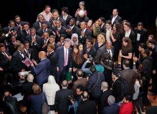 Ambassador John Desrocher, center with pink tie, and his spouse, Karen Rose, to his right, pose for a photo with some of the members of the Algerian Higher School of Music and the Morehouse College Glee Club, after their final concert at the National Theatre of Algiers, Jan. 3, 2019. Photo by Farid Azira