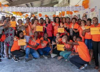 After weekend-long protests and security restrictions in Port-au-Prince, Ambassador Sison, center in red jacket, and representatives from UN Women launch the international campaign, 16 Days of Activism Against Gender-Based Violence, on Nov. 26, 2018. Photo courtesy of Embassy Port-au-Prince