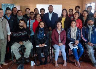 Human Resources Officer Andre Jennings, center in blue jacket, and Human Resources Specialist Rhitu Shrestha, right of Jennings, host a training session on behalf of Embassy Kathmandu's Diversity and Outreach Program with students at American Corner Surkhet. Photo by Hirdesh Kumar K.C.