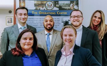 Teams are an integral part of Watch culture and form the backbone of fast-paced task forces. Members of the Ops team (from left) Carolina Ardon Ayala, Christopher Bodington, Jared Yancey, Elaine Kelley, John Ambrose and Betsy Bennion stand outside their office. Photo by James Kaelin