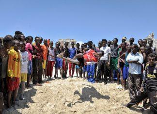 Boys practice their acrobatic skills on Lido beach, Mogadishu. Photo by Tobin Jones