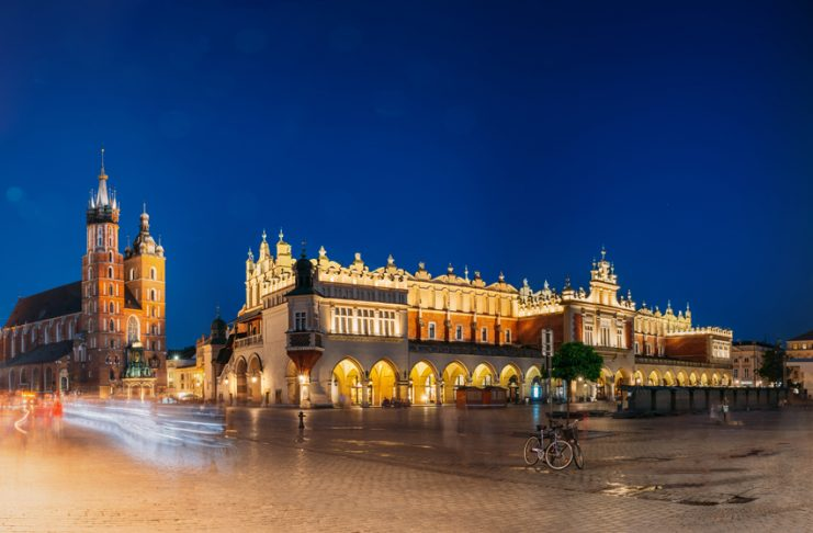 Landmarks like St. Mary's Basilica, Cloth Hall Building and Old Town Hall Tower can be seen in this panorama of Old Town Square. Photo by Grisha Bruev