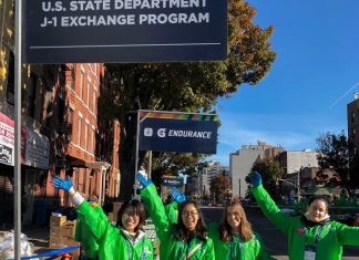 More than 1,000 ECA exchange visitors volunteered at fluid stations along the 26.2 mile NYC marathon course. Photo by Jenny Eisenberg