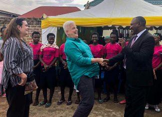 Ambassador Deborah Malac greets Community Volunteer Initiative for Development Executive Director Ben Bataringaya at the grand opening and commissioning of the COVOID Youth Empowerment Center in Rubirizi, Uganda. Photo by Khue Nguyen