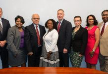 """Members of the Department's OSDBU, (from left) George Price, director; Thelma Edmunds, procurement analyst, Shahrokh """"Peter"""" Zahirieh, senior procurement analyst; Patricia Foster, administrative manager; Rich Vinnacombe, deputy director; Anna Urman, senior procurement analyst, Renee M. Hill, small business liaison; and Dr. J. Anthony Josey, senior procurement analyst. Photo by Luis A. Jimenez Jr."""