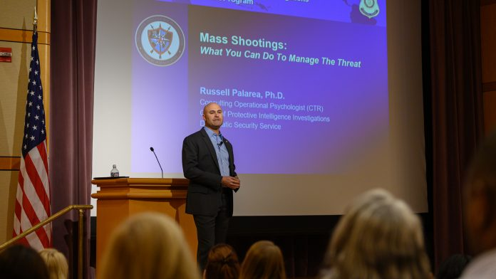 """Russell Palarea, an operational psychologist in the Diplomatic Security Service office gives a presentation """"Mass Shootings: What You Can Do To Manage the Threat"""" as part of National Insider Threat Awareness Month activities, Sept. 11. Photo by Luis A. Jimenez Jr."""