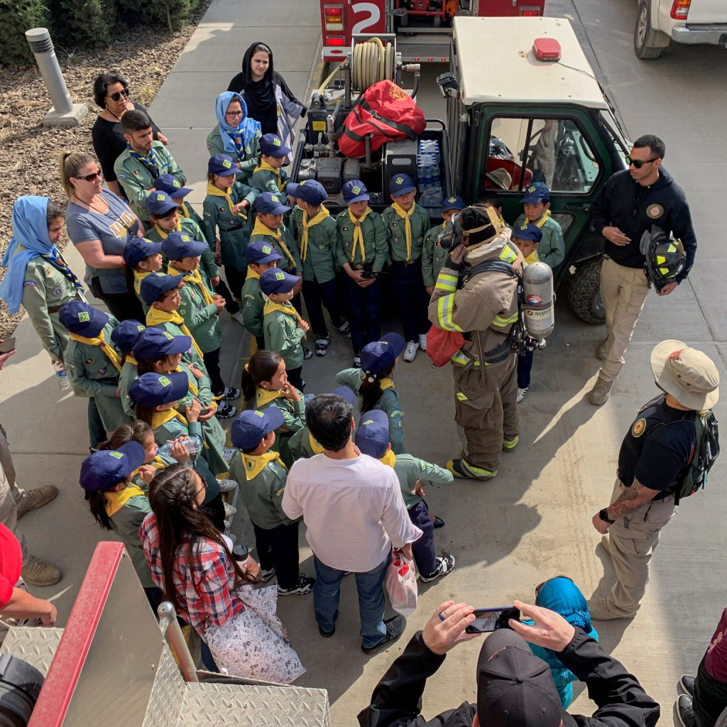 Kabul firefighters demonstrate the self-contained breathing apparatus to Afghan scouts during a visit on Children's Peace Day, April 2019. Photo by Robert Baldrate