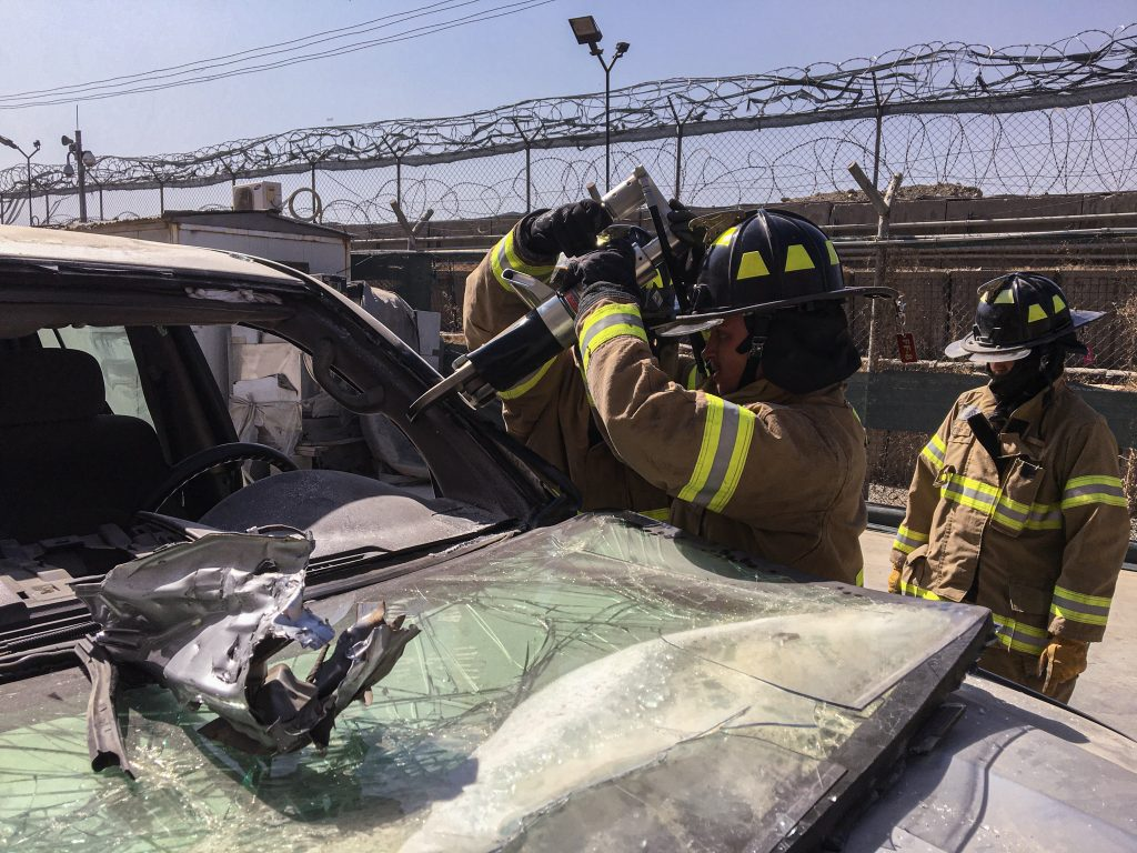 Kabul firefighters get hands-on experience utilizing the Jaws of Life cutting tool during a training exercise, Sept. 2019. Photo by Robert Baldrate
