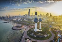 The Kuwait Towers rise in the foreground of a beautiful sunset over Kuwait City. Photo by ADionisio
