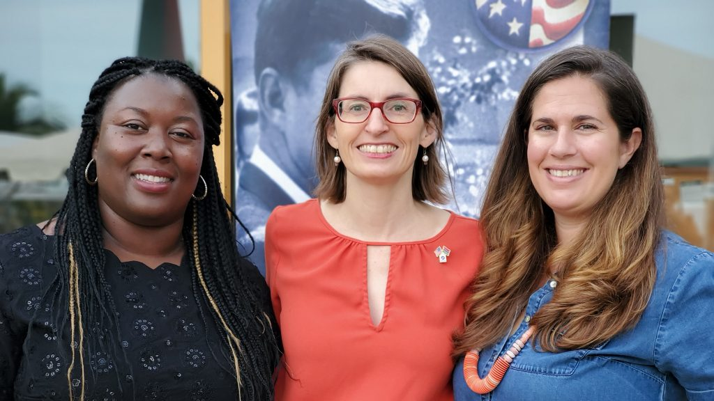 From left: Kelleah Young, Rene Rohrs, and Megan Wilson make up the Peace Corps leadership team, who guides more than 100 volunteers through their service in The Gambia. Photo by Kathryn Edwards