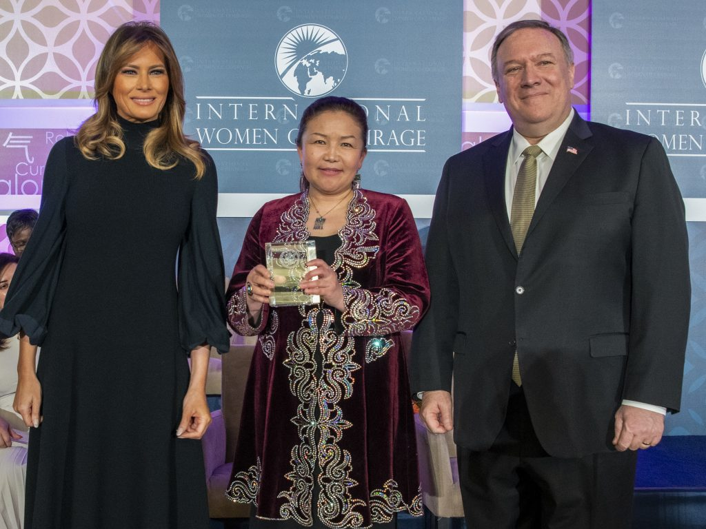 From left: First Lady Melania Trump, Sayragul Sauytbay, and Secretary of State Mike Pompeo pose together after Sauytbay received an International Women of Courage Award in Washington, D.C., March 4. Photo by Freddie Everett