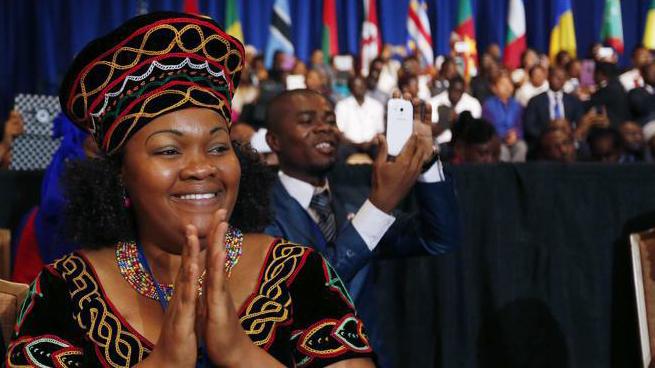 2014 Fellowship alumna Christelle Bay Chongwain of Cameroon claps during a plenary session at the 2014 Mandela Washington Fellowship Summit. Photo courtesy of IREX