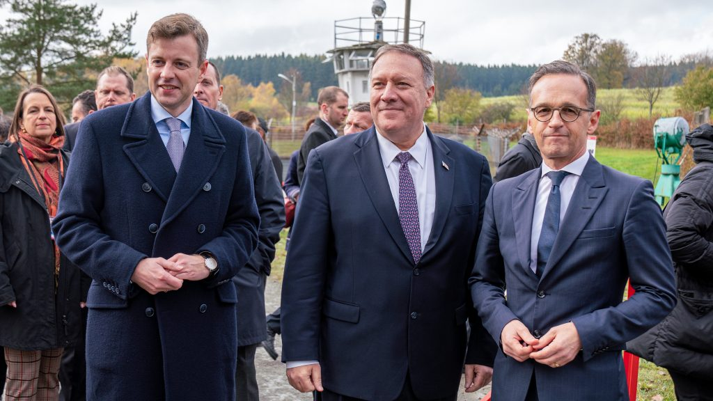 """U.S. Secretary of State Mike Pompeo (center) greets German Foreign Minister Heiko Maas (right) in the town of Moedlareuth—formerly known as """"Little Berlin"""" because of the wall that existed there along the former 'German-German border'—to celebrate the 30th anniversary of the fall of the wall, November 2019. Photo by Ron Przysucha"""