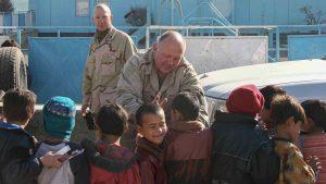 Steve Rudock high-fives children at Alauddin Orphanage in Kabul, Afghanistan. Photo courtesy of Steven P. Rudock