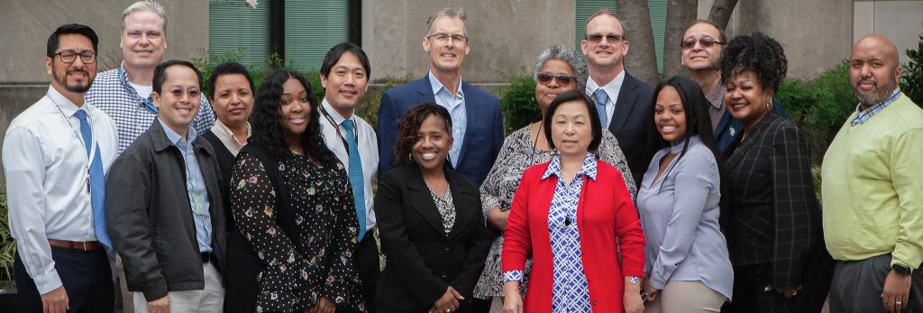 A group photo of key members of the Email Division (EML) team that were involved with the ISO 20K certification. From left: Chris Escobar, Harry Patterson (back), Quang Bui, Adiam Habtemariam, Tamika Dixo, Robert Choy, Daphne Gray (front), John McElroy (back), Sheila Kenner (back), Hae-Jung Goldman (front), Trey Jammes (back), Shalea Leftenant, Otis Perry, Anita Henderson-Carlos, and Jamell Jackson. Photo courtesy of Email Division