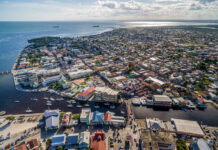 An aerial view shows the coastline and bustling architecture of Belize City. Photo by Photosounds
