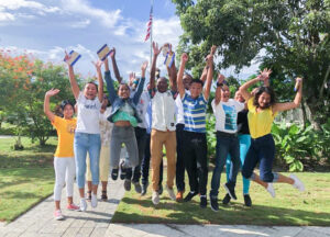 Youth Ambassador Program participants celebrate their selection into the program outside the embassy building. The program has provided opportunities to dozens of talented Belizean youth, ages 15-18, to travel to the United States to develop leadership skills and learn about U.S. culture and society. Photo courtesy of Mission Belize