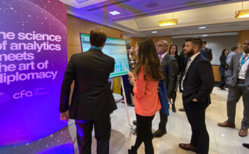 """Data enthusiasts get a first look at the Center for Analytics' products during a demonstration outside of the George C. Marshall Conference Center during the """"Data for Diplomacy"""" launch, January 2020. Photo courtesy of M/SS"""