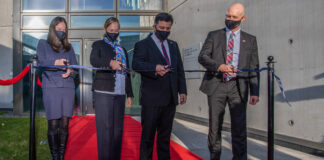 From left: Deputy Chief of Mission Michelle Yerkin, the ambassador's partner Heather J. Wilson, Ambassador Jeffrey Ross Gunter, and Management Officer Scott Dargus cut the ceremonial ribbon officially opening the new embassy compound in Reykjavik, Oct. 20. Photo by Haraldur Guðjónsson