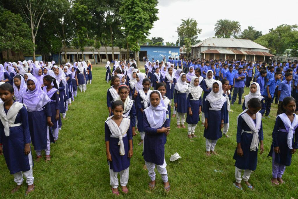 Bangladeshi students stand in alignment at a school ground in Manikganj near Dhaka. Photo by Mamunur Rashid