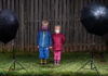 The author's children pose for portrait in their backyard, March, 24, 2020, during their second week of virtual school.