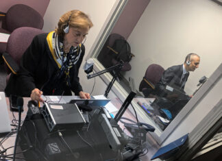 From left: Department of State Spanish interpreter Irene Bruno and Japanese interpreter Lefteris Kafatos interpret in the Hub for a remote meeting. Photo by Erric Briggs