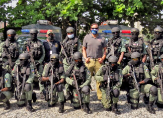 Police with the Lagos Special Program for Embassy Augmentation Response (SPEAR) team pose alongside U.S. Diplomatic Security Service (DSS) counterparts, including Consulate Lagos Regional Security Officer Special Agent James Suor (middle, khaki pants), November 2020. SPEAR teams are quick-response forces trained and funded by the DSS Office of Antiterrorism Assistance. State Department photo