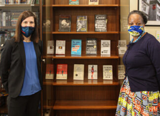 Mission Bosnia and Herzegovina Diversity and Inclusion Working Group co-chairs Star Hy (left) and Shamaine Martin-Crick (right) open the Mission's Diversity Book Library, January 2020. State Department photo