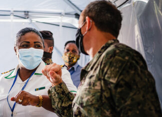 Commander Sonia Miller of the Royal Bahamas Defence Force (left) greets U.S. Embassy Senior Defense Official, Commander Kevin Self (right), upon receiving $20,000 in equipment to aid in the fight against coronavirus in The Bahamas. Photo by Daniel Durazo