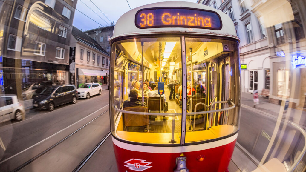 A nighttime, old-fashioned tram ride through Vienna, a city that has an extensive train and bus network. Photo by Travelview