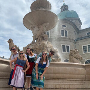 Tri-Mission community members pose in front of the Residenz Fountain in Salzburg, Austria. This fountain was a stop on the Sound of Music Bike Tour organized by the Community Liaison Office, August 2020. Photo by Elizabeth Rowe