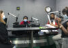 Broadcast journalism students conduct a live interview with Ambassador Jeanne Maloney (left) at UNESWA FM 88.2, March 31. Photo by Stephanie Sandoval