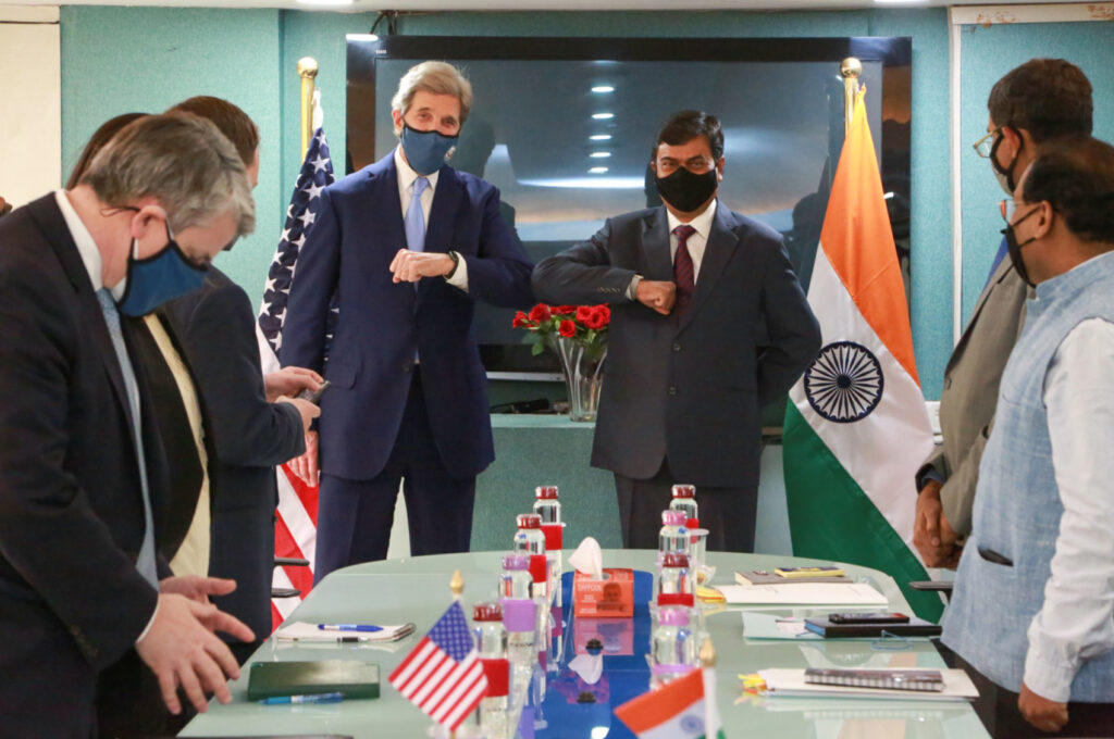 Special Presidential Envoy for Climate John Kerry (back left) traveled to India to discuss decarbonization through investment in a clean transition. Photo by Rakesh Malhotra