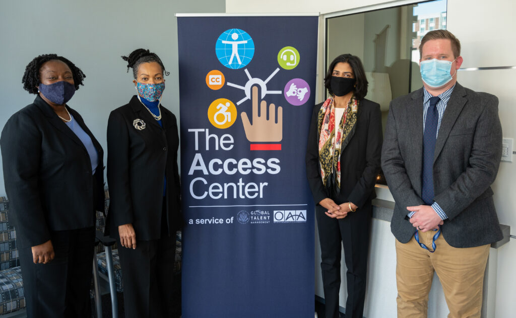 Ambassador Gina Abercrombie-Winstanley (second from left) visits the Access Center with Office of Accessibility and Accommodations team members, April 23. Photo by Heidi Howland