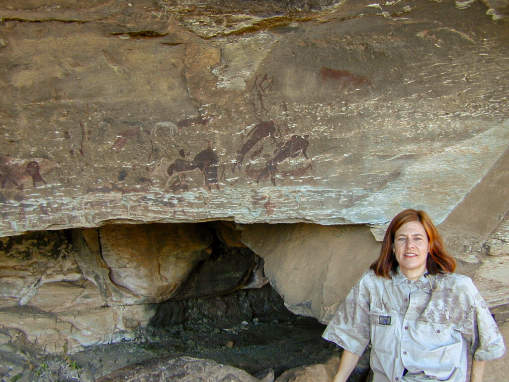 Fulbright Scholar Patty Bass at Game Pass, Kwa-Zulu, Natal, one of her field sites in South Africa, 2000. At the Game Pass research site Bass recorded, studied, and taught by the Rock Art Research Institute of the University of Witwatersrand in Johannesburg, South Africa. Bass is now a Fulbright program officer in the Bureau of Educational and Cultural Affairs. Photo courtesy of Patty Bass