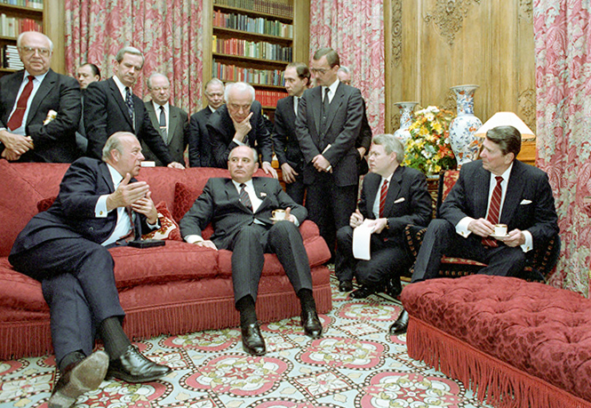 President Ronald Reagan (far right) meets with Soviet General Secretary Mikhail Gorbachev (front, second from left) along with George Shultz (front, far left), Robert McFarlane (standing, second from left), Anatoly Dobrynin (standing far left) and Eduard Shevardnadze (leaning over Gorbachev) at Maison de Saussure during the Geneva Summit, Nov. 20, 1985. Photo courtesy of the National Archives Catalog