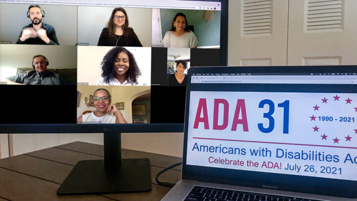 The speakers are shown on a screen on the left, while a laptop has the ADA 31 logo on it in front.