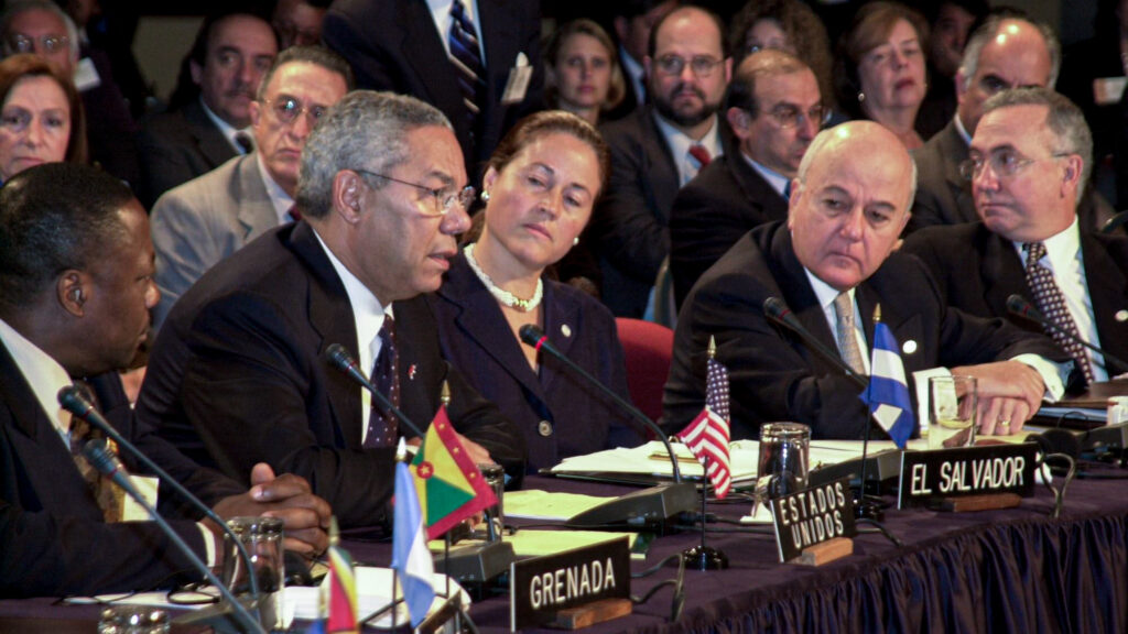 Then-Secretary of State Colin Powell addresses the Organization of American States General Assembly in Lima, Peru moments after the terrorist attacks on the World Trade Center, Sept. 11, 2001. In light of this tragedy, he asserted that the proposed Inter-American Democratic Charter would be more important than ever in the hemisphere. Photo courtesy of the Columbus Memorial Library