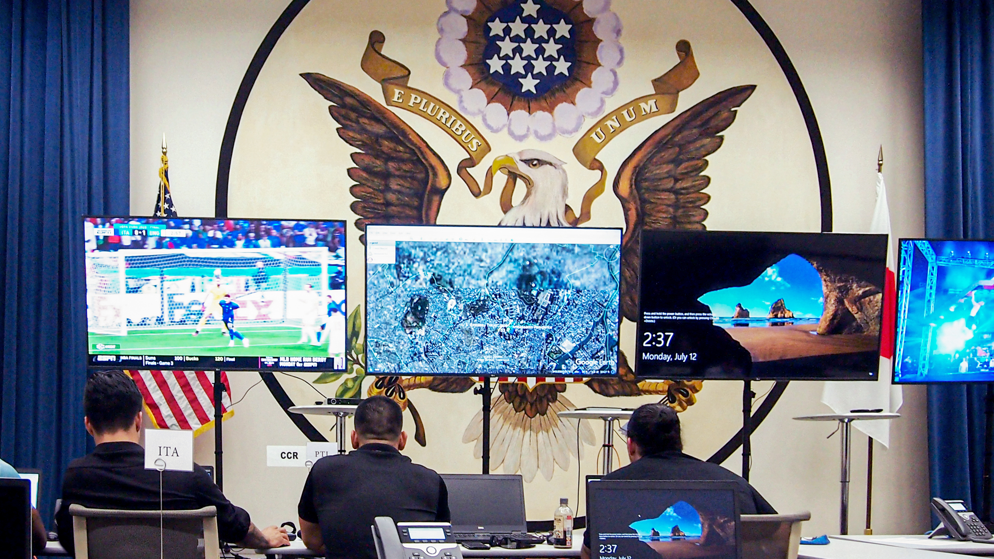 Diplomatic Security Service personnel and interagency partners work at the Joint Operations Center, which provides TVs with a bird's-eye view of the Olympic games, July 12. Photo by Angelica Harrison
