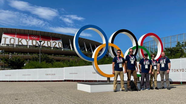 Diplomatic Security Service special agents serving as field liaison officers at the 2020 Tokyo Olympics pose in front of the Olympic Rings in Tokyo, July 16. Photo courtesy of the Diplomatic Security Service