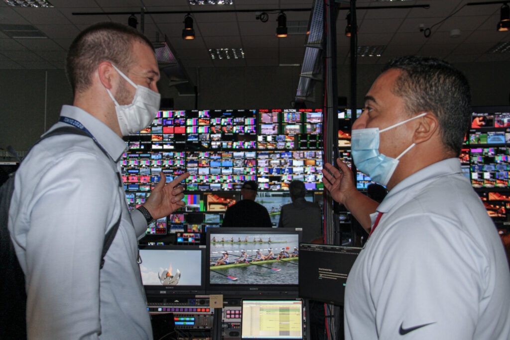 Overseas Security Advisory Council Major Events Manager Phil Walker (left) meets with NBC's vice president of global security in one of NBC's control rooms at the 2020 Tokyo Olympics, July 24. Photo courtesy of the Diplomatic Security Service