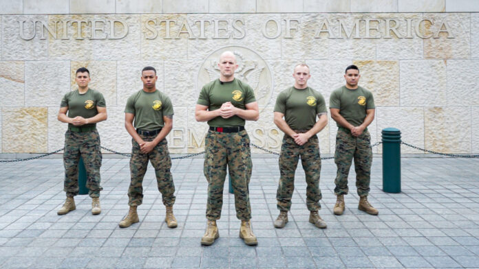 """From left: Staff Sgt. José Mireles, Staff Sgt. Dwight Patterson, 1st Sgt. Daniel Best, Staff Sgt. Devin Valleroy, and Sgt. Hector Ontiveros during the filming of the """"Train Like a Marine"""" series on Embassy Bogota's campus. Photo by Juan Sebastian Silva"""