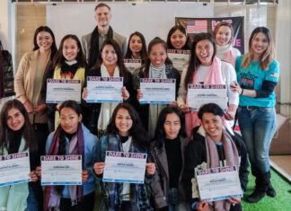 Cultural Affairs Officer Karl Rogers (back row) stands with Dare-to-Shine Program participants. Photo courtesy of the WE United Project