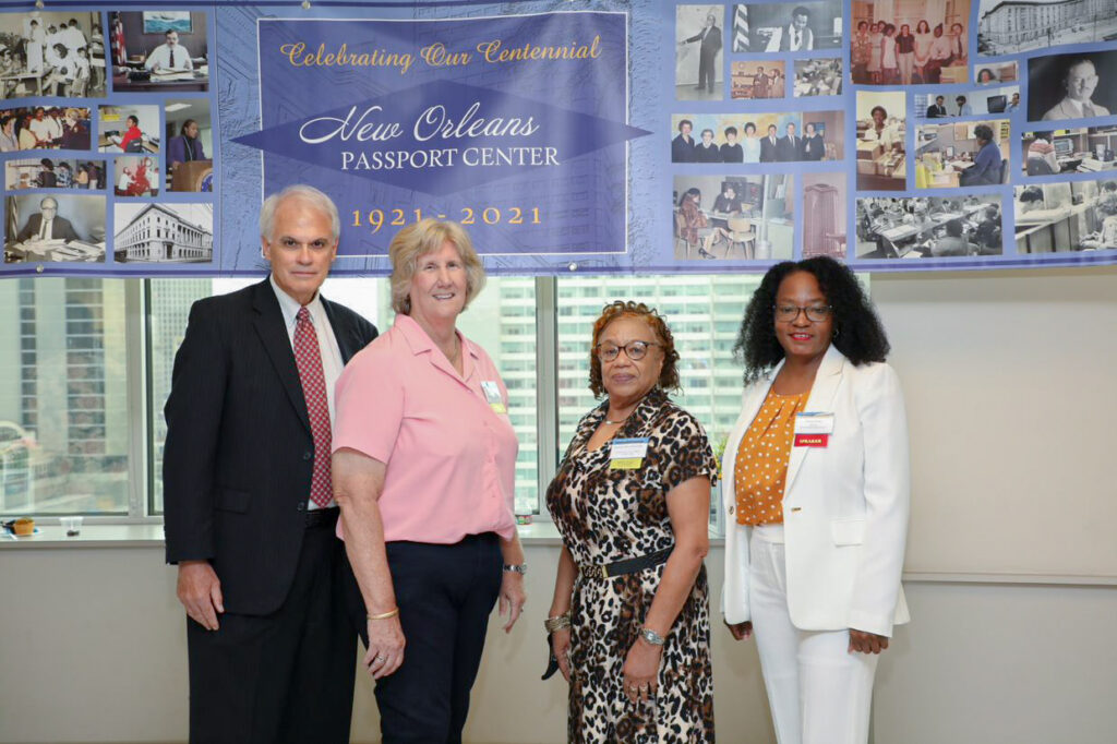 From left: retired-New Orleans Passport Center Customer Service Manager Philip Pusateri, retired-Directors Carolyn Kieffer and Beverly Hitts-Christophe with current Director Stacey Porter at the Centennial Celebration, July 8. Photo by Christopher Kenney