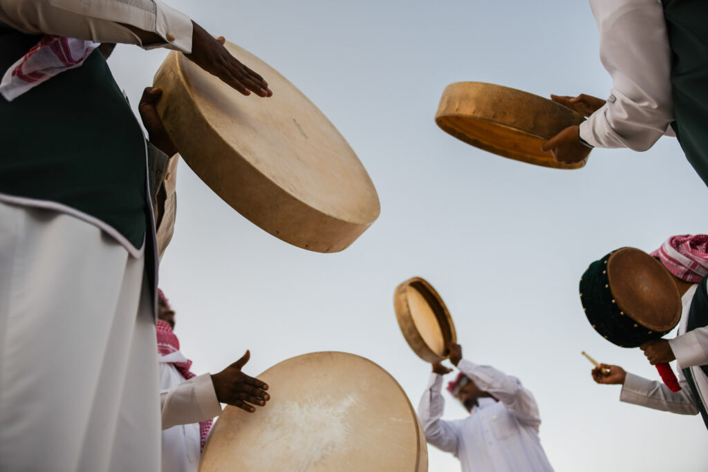 A group of men perform a traditional Saudi Arabian dance in a Janadriyah Festival. Photo by H1N1