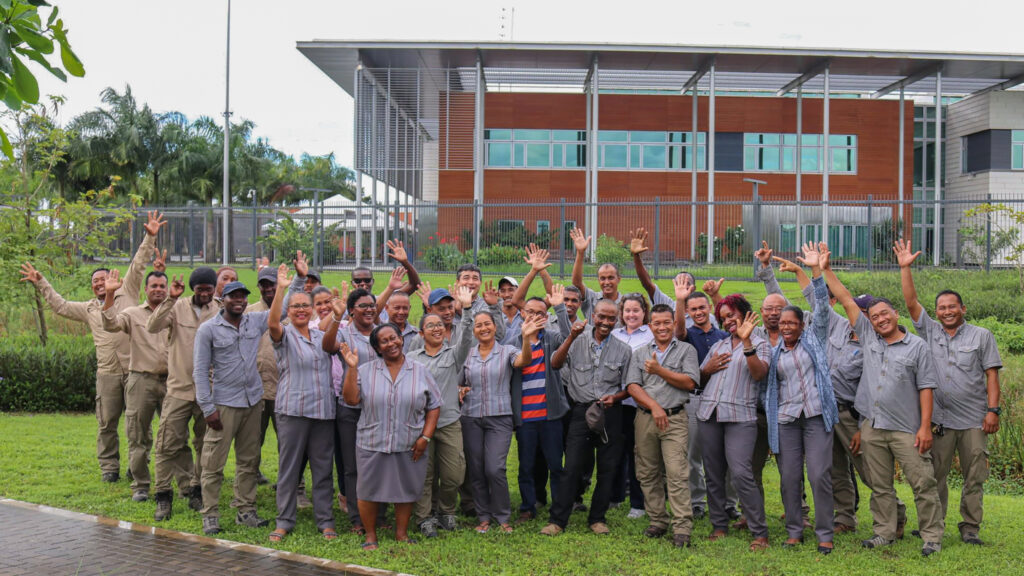 Facility Manager Rebecca Beatty (second row, fifth from right) stands at Embassy Paramaribo with her former staff, several that are locally employed. Beatty is currently the facility manager at Embassy Lisbon. Photo courtesy of the Bureau of Overseas Buildings Operations