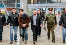 A Diplomatic Security Service special agent (fourth from right) along with U.S. and Armenian law enforcement officials return a U.S. fugitive wanted for second-degree sexual abuse. The fugitive pleaded guilty in May 2018 and is serving 25 years in the state of Iowa. Photo courtesy of the Bureau of Diplomatic Security Service